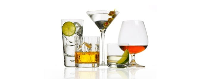 Product photography of various liquors in different glasses.